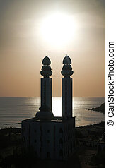 Contre-jour view to Mosque of the Divinity at sunset, Dakar,...