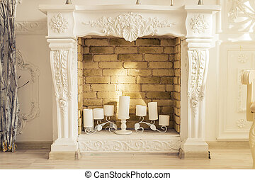 White decorative fireplace with candles