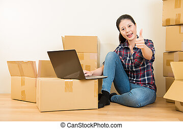 woman thumbs up with computer - Moving to new house and...