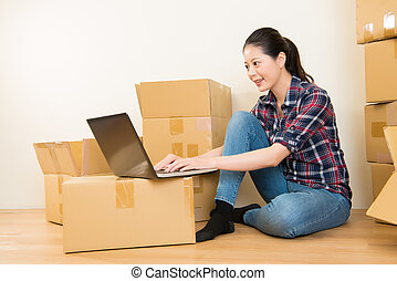 woman working online during relocation