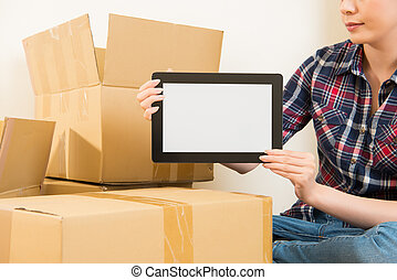 moving house with digital tablet to research