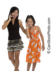 mother and daughter on the phone, isolated on white...
