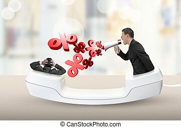 Telephone handset with businessman yelling at another man -...