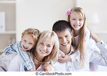 Happiness - Portrait of a happy family with two children at...