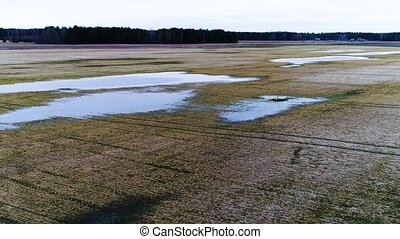 aerial view of flooded fields and lakes at spring - aerial...