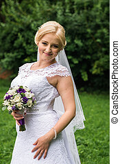 Bride posing in her wedding day - Beautiful bride with a...