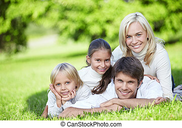 Happy family - A happy family with two children outdoors
