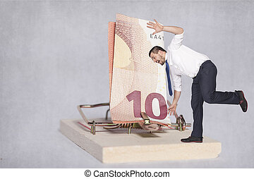 businessman teetering on the edge of risk