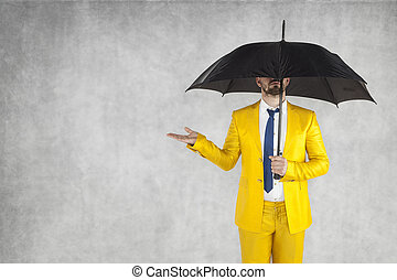 insurance agent under the umbrella, next to the copy space