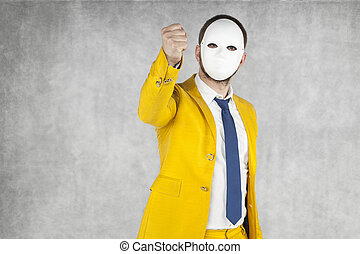someone threatens fist, mask on the face