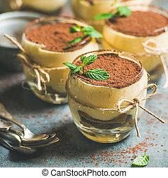 Homemade Italian dessert Tiramisu served in individual...