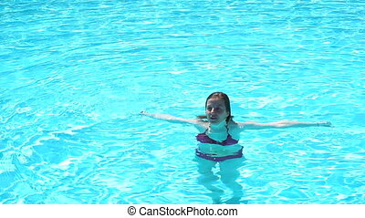 Woman in summer snorkling in the swimming pool in slow...
