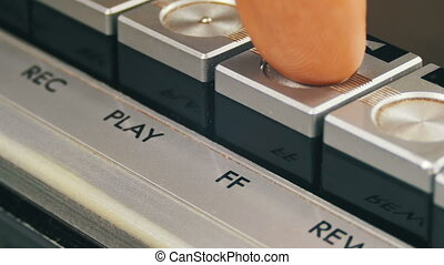 Pushing Forward Button on a Vintage Tape Recorder. Close-up....
