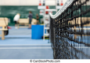 Close up view of tennis court through the net - Close up...