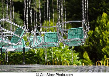 empty swing in theme park - empty swing chairs in a dutch...