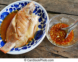 Steamed Nile tiapia fiah with spicy seafood sauce - Steamed...