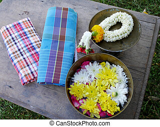 Traditional thai in Songkran day bring garland and petal...