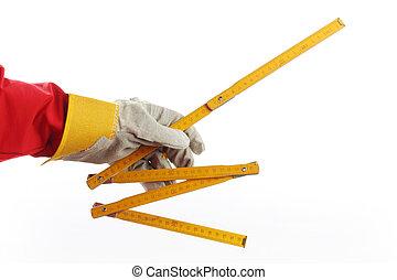 yardstick - A worker holding yardstick over white background
