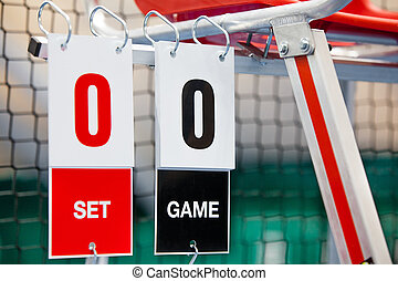 Umpire chair with scoreboard on a tennis court before the...