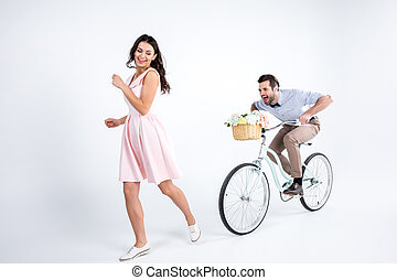 Young man and woman - Happy young woman running from man...