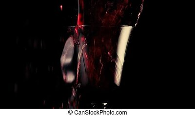 Red wine falls into a beautiful goblet - In a beautiful...
