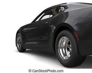 Dark grey modern fast car - rear wheel focus shot
