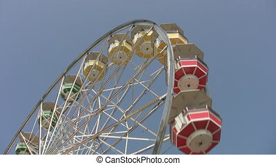 Ferris wheel - Big ferris wheel with multi-coloured cars at...