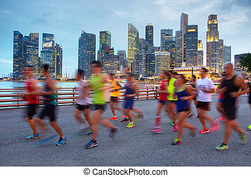 Running in Singapore - Group of runners on Singapore...
