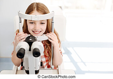 Admirable pretty child having a general eyesight checkup
