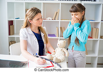 Doctor giving a gift to a girl