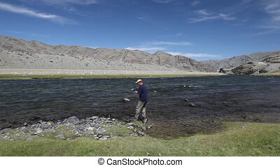 Fisherman with spinning