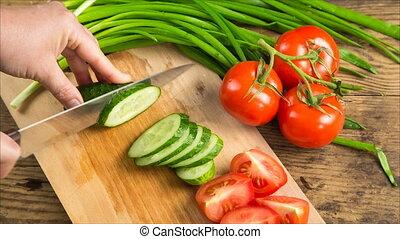 Cut cucumber on wooden cutting board - Cut cucumber with...