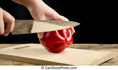 Cut red paprika on wooden cutting board - Cut red paprika...