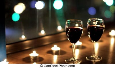 The radiance reflected in glasses with wine during a...