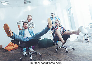 Low angle of cheerful office workers having fun - Have a...