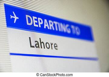 Computer screen close-up of flight to Lahore - Computer...