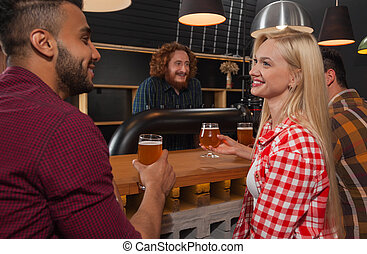 Young People Group In Bar, Couple Sitting At Wooden Counter...