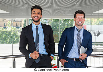 Two Business Man Happy Smile Standing At Modern Office,...