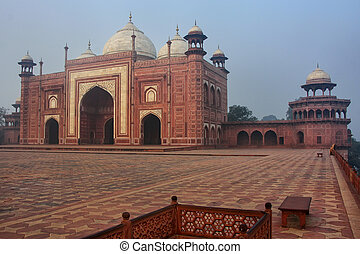 View of the mosque at Taj Mahal complex in early morning,...