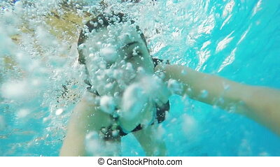 Girl in the pool under the water