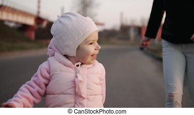 Little Girl Running Away from Mother Playing Outdoors. Child Having Fun. Slomo