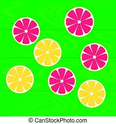 Slices of lemons and grapefruits on green wood table. Healthy eating with natural vitamins.