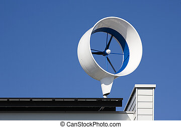 Residential wind turbine on a house in Almere, the...