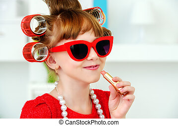 fashion kids party - Portrait of a funny little girl with...