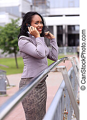 happy young businesswoman talking on cell phone