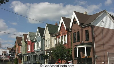 Row of homes. Timelapse clouds. - A line of Victorian houses...