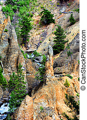 Pinnacle Fronts Tower Falls - Stone pinnacle stands in front...