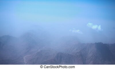 View on desert with mountains from airplane in the sky