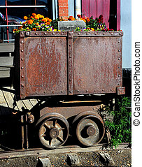 Mining Cart Garden - Flowers grow in a make-shift garden...