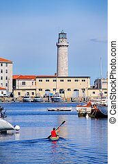Boat marina and lighthouse in Trieste, Italy. Trieste is the...